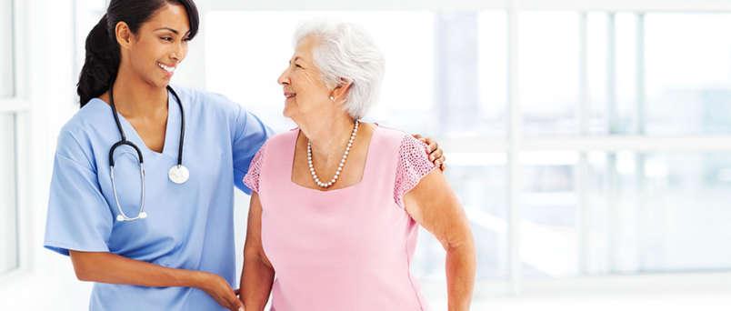 Caregiver and arm around senior