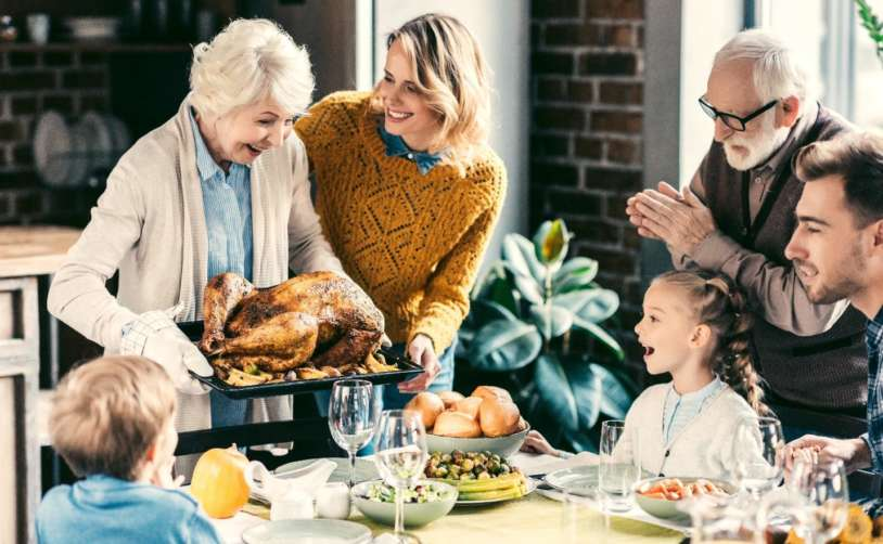 a family enjoying a turkey dinner