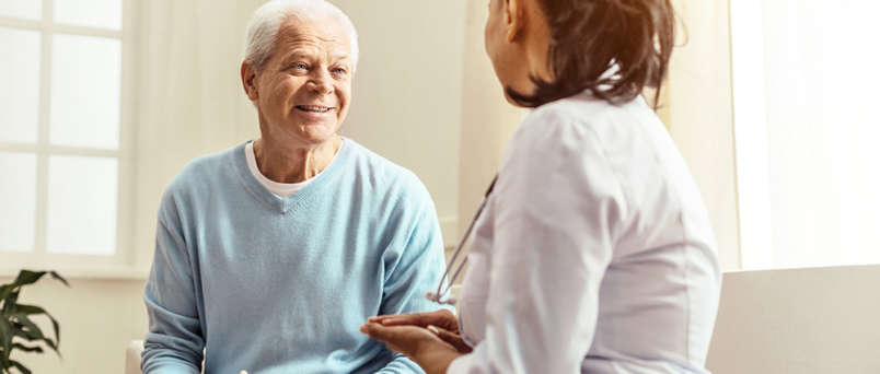 doctor meeting with an elderly patient