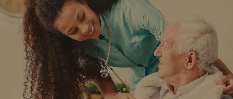 Senior being helped by a nurse