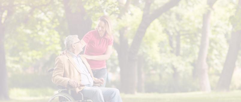 a caregiver assisting an elderly man in a wheelchair
