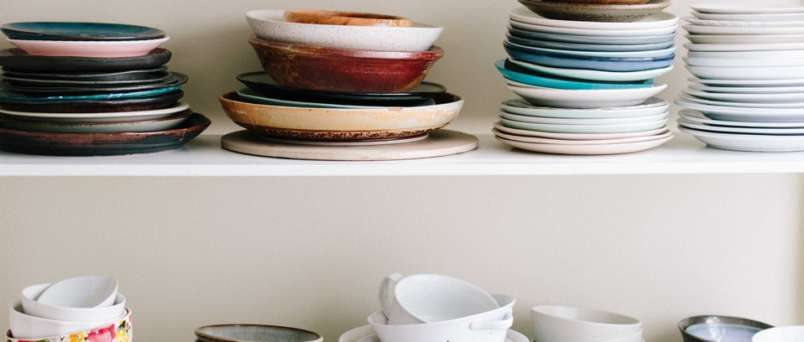 a cupboard full of plates and bowls