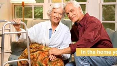 senior couple on sofa at home.