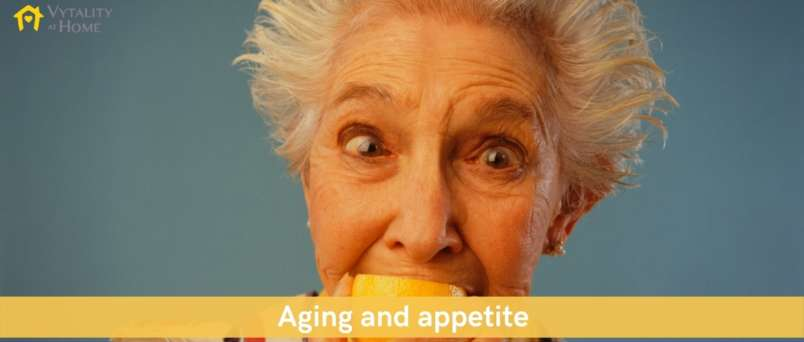 Senior lady eating lemon for healthy eating
