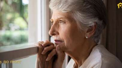 lonely senior looking out window